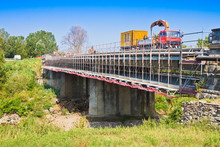 Restoration Of An Old Damaged Concrete Bridge Crossing A River With Truck Working