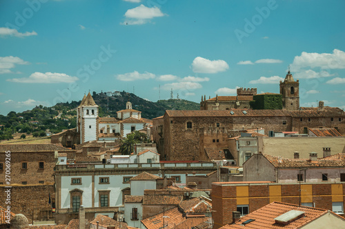 Foto op Plexiglas Marokko Cityscape with old building roofs and church bell tower at Caceres