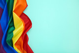 Fototapeta Rainbow - Rainbow flag on blue background