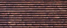 Dark Treated Logs Lying On Top...