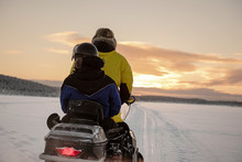 2 People Riding On A Snowmobil...