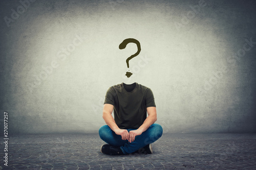 Fotografía  Surreal headless guy, invisible face seated on the floor with a question mark in
