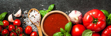 Tomato Sauce, Fresh Tomatoes, Spices And Basil Leaves On Black Background