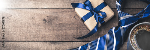 Gift Box Tie And Hot Coffee On Wooden Table With Sunlight - Fathers Day Concept - 270091878