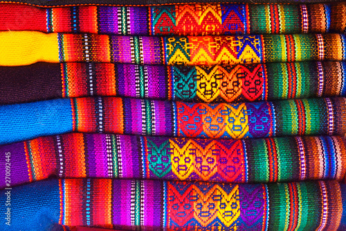 Peruvian traditional colorful native handicraft textile fabric at market in Machu Picchu, one of the New Seven Wonder of The World, Cusco Region Peru, South America Poster Mural XXL