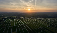 Aerial View Of Cultivated Reclaimed Land In The Netherlands At Sunset