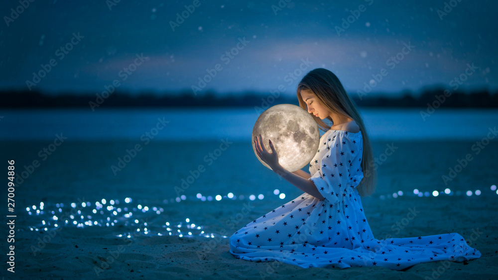 Fototapety, obrazy: Beautiful attractive girl on a night beach with sand and stars hugs the moon, Artistic Photography