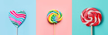 Three Colorful Lollipops Candy As Heart And Swirl On Blue And Pink. Funny Concept. Top View. Collage.