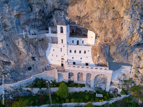 Slika na platnu Monastery of Ostrog is a monastery of Serbian Orthodox Church placed against an almost vertical rock of Ostroska Greda, Montenegro, Europe