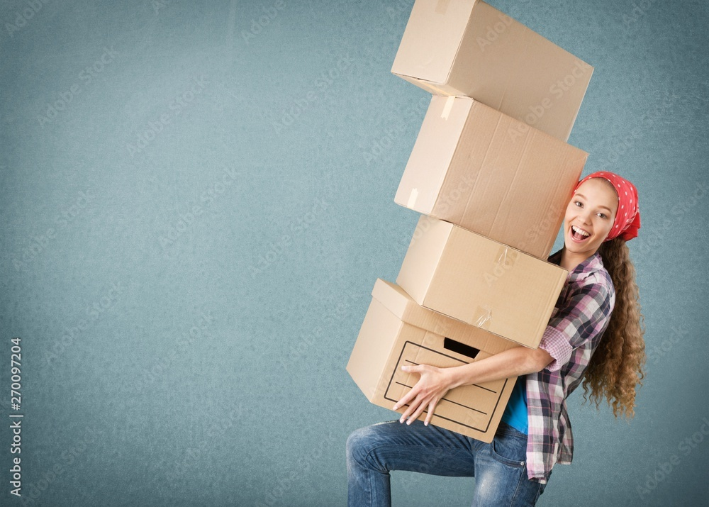 Fototapety, obrazy: Delivery man carrying stacked boxes in front of face against  background