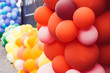 A lot of multicolored balloons, orange and red, pride festival