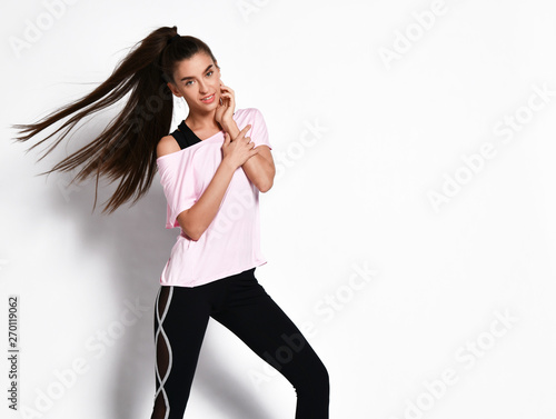 Sporty slim brunette with ponytail fitness woman in fashion black and white sportswear on white Wall mural