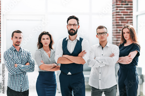 Fototapety, obrazy: confident business team standing in a modern office
