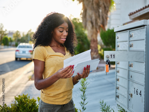african american woman checking mail in las vegas community Canvas
