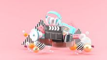 Filmstrip And Clapper Movies And Entertainment On Pink Blackground.-3d Rendering.