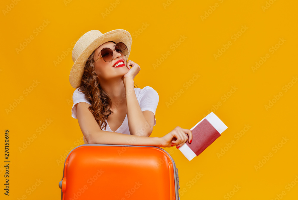Fototapety, obrazy: concept of travel. happy woman girl with suitcase and  passport on  yellow background.