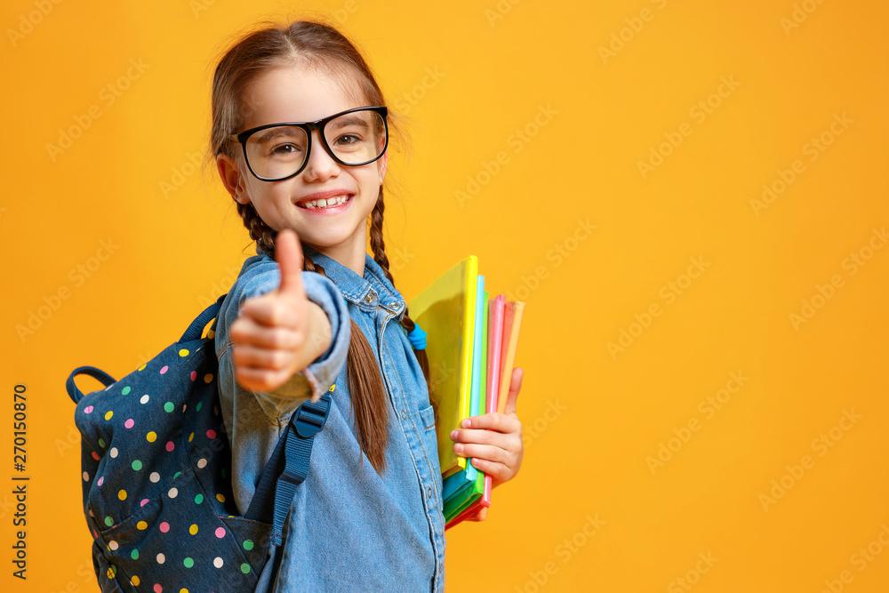 Fototapety, obrazy: funny child school girl girl on yellow background    .