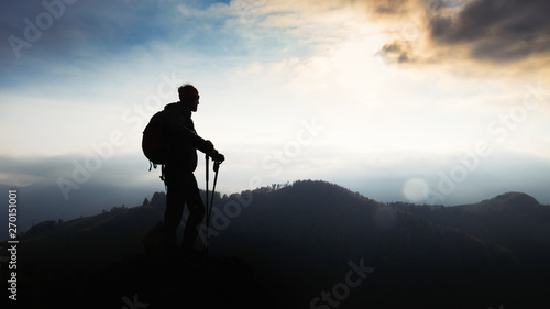 Fotografie, Obraz Man during a religious pilgrimage walks at sunset