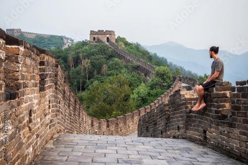 Photo Traveler at the Great Wall of China near Beijing, China.