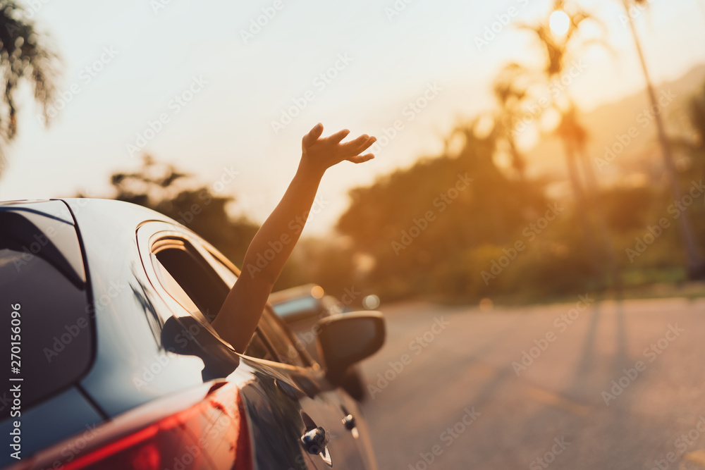 Fototapeta Hatchback Car travel driving road trip of woman summer vacation in blue car at sunset,Girls happy traveling enjoy holidays and relaxation with friends together get the atmosphere and go to destination