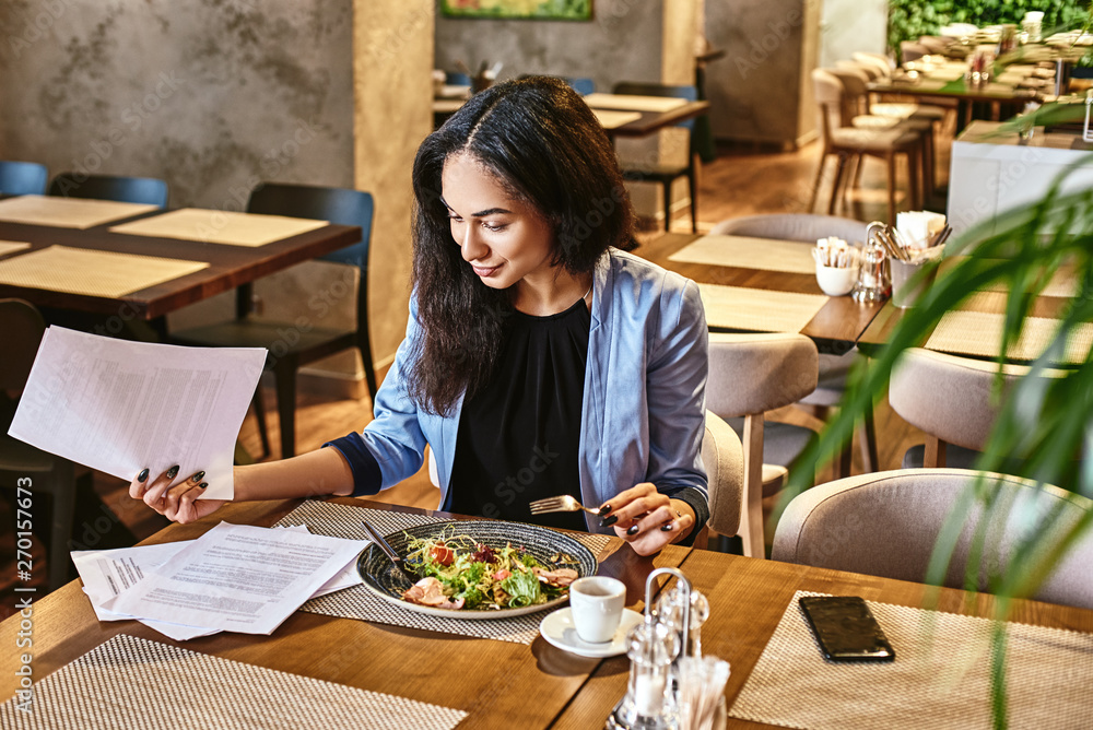 Fototapety, obrazy: Lunch matters. Businesswoman having lunch in company's restaurant. Cozy interior