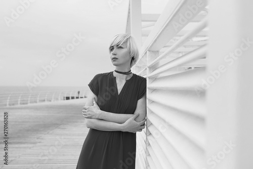 Fotografie, Obraz  monochrome portrait of pretty cool beautiful short hair blonde woman in short su