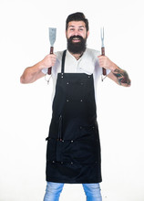 He Is A Great Cook. Happy Grill Cook With Cooking Utensils. Bearded Man Holding Fork And Spatula For Cooking And Serving Barbecue. Master Cook Wearing Grilling Apron. Chief Cook In Workwear. Cookout