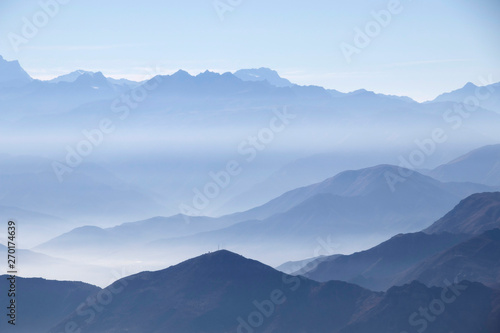 Misty blue Andean mountain landscape background - 270174639