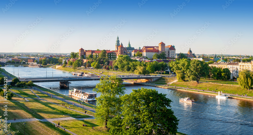 Fototapety, obrazy: Poland. Krakow aerial panorama with historic royal Wawel castle and cathedral, Vistula river with a bridge, boats, on board restaurant. Promenades and parks along the riversides. Sunset light