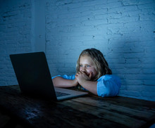 Sad Young Girl With Laptop Suffering Bullying And Harassment Online. Cyber Bullying Victim