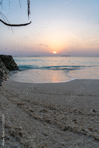 Fotografering sunset view on maledives with sand in foreground