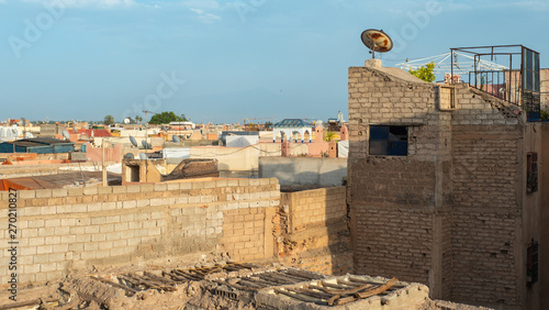 Photo sur Toile Con. Antique Marrakech panoramic top view of old medina streets. Old Building ruins and red walls of old town on sunset
