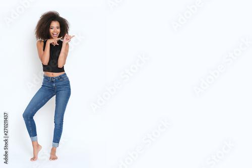 Leinwanddruck Bild - forma82 : Pretty afroamerican girl showing a banner the left.