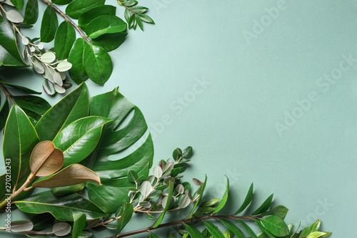 Obraz Tropical leaf frame on green background with copy space. Flat lay. Top view. Summer or spring nature concept. Leaves mock up - fototapety do salonu