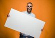 canvas print picture - Hipster man holding a poster with blank space for your text.
