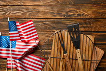 Top View Of American Flags Near Bbq Equipment On Wooden Rustic Table
