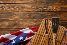 Top View Of Crumpled American Flag And Bbq Equipment On Wooden Rustic Table With Copy Space