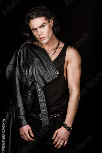 handsome and serious man in leather jacket looking at camera isolated on black Tapéta, Fotótapéta