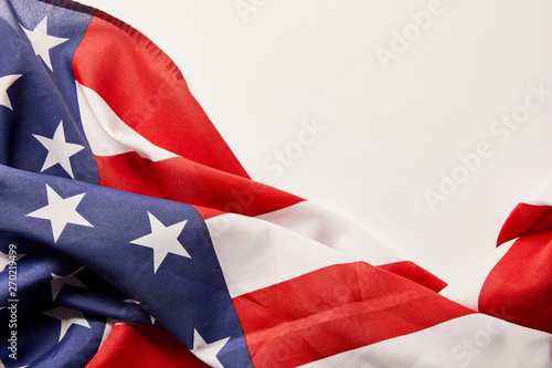 Canvas Prints Textures top view of crumpled stars and stripes on white background with copy space