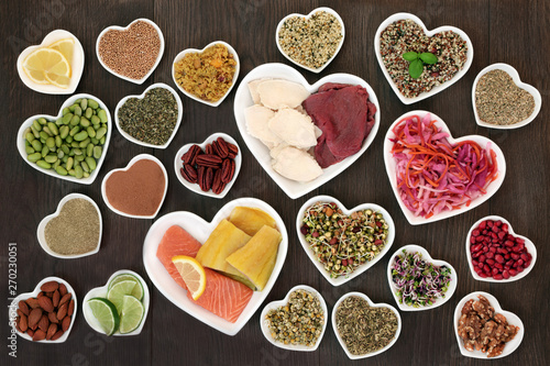 Fototapety, obrazy: Diet health food selection for weight loss including vegetables, fish, meat, salad grains, nuts, seeds, supplement powder and herbs used in herbal medicine to help with dieting. Top view on oak wood.