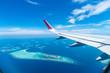 Leinwandbild Motiv Maldives islands top view from airplane window
