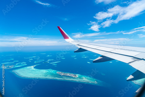 Photo sur Aluminium Avion à Moteur Maldives islands top view from airplane window