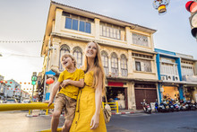 Mom And Son Tourists On The Street In The Portugese Style Romani In Phuket Town. Also Called Chinatown Or The Old Town. Traveling With Kids Concept