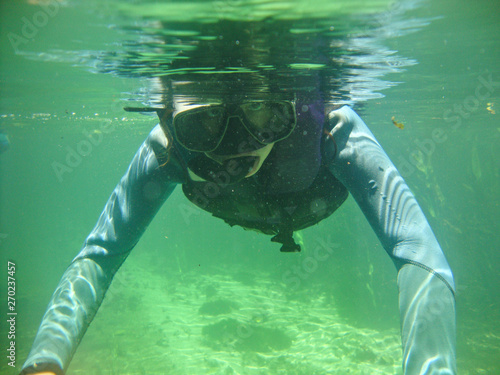 Fotografija  Girl snorkeling at Sucuri river water surface, crystal clear, transparent blue r