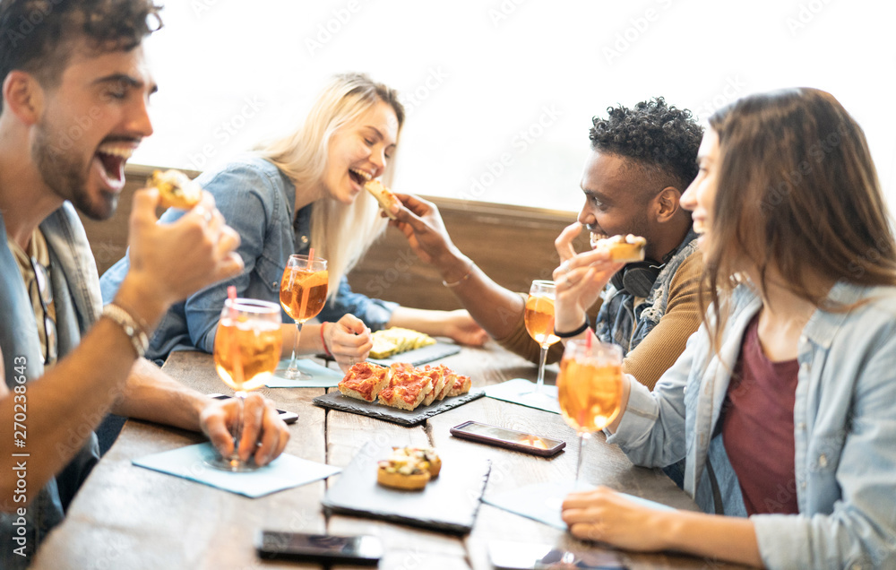 Fototapety, obrazy: Friends eating and drinking spritz at fashion cocktail bar restaurant - Friendship concept with young people having fun together with drinks and food on happy hour at pub - Focus on pizza slices