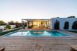 Leinwanddruck Bild - Modern villa with pool and garden