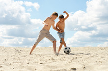 Two Brothers Playing Football ...