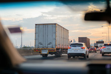Car And Trucks In Traffic Jam On Highway In Rush Hour.