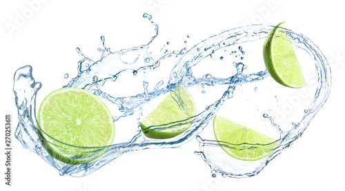 Photo  Slices of juicy lime and splashing cold water on white background