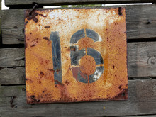 Old Vintage Number Sixteen Door Plate On Old Wooden Fence